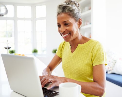 woman sitting down using the computer